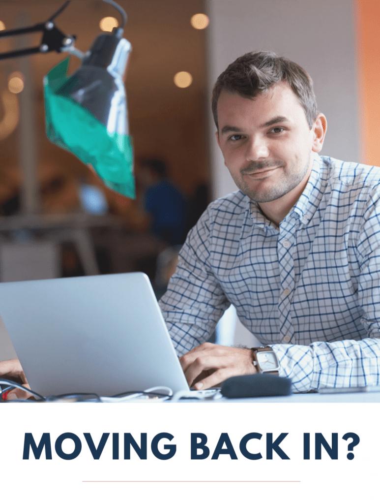 Man on laptop smiling